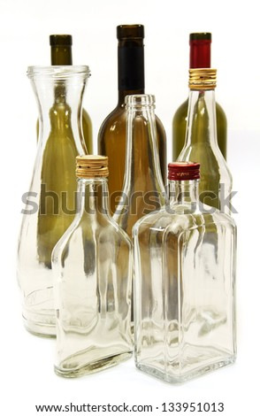 a few empty bottles of wine and alcohol in transparent and colored glass.