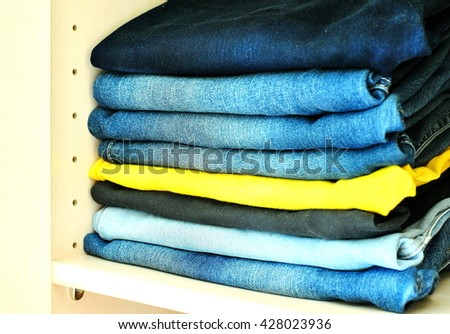 A few jeans in the closet #428023936