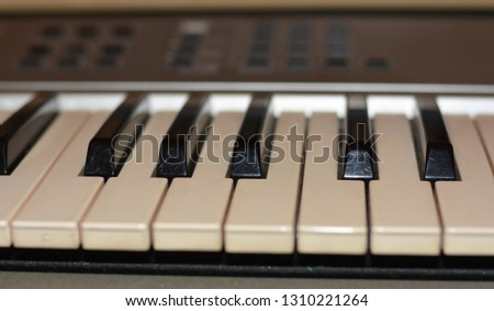 a few keys of electric music keyboards instrument #1310221264