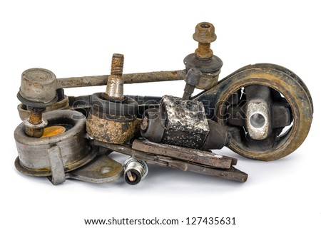 A few old, worn out and rusty car parts