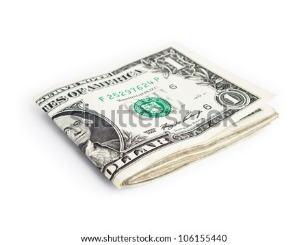 A few one dollar bills folded in half isolated on white background.