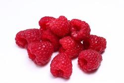 A few raspberries on a white background