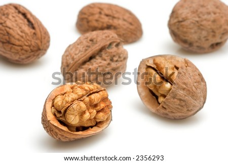 A few walnuts against white background