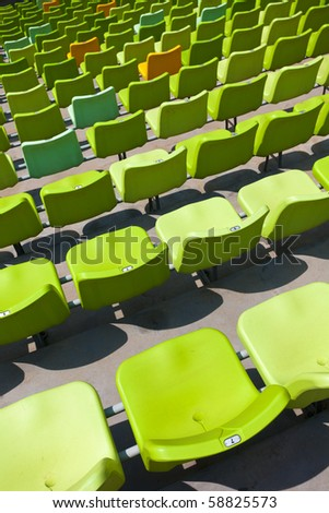 A field of empty seats in a open stadium in china outdoor.