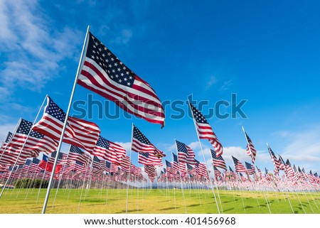 a field of hundreds of american ...