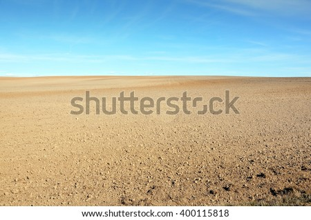 A field of plowed ground on a background of blue sky. Сток-фото ©