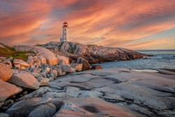 A fiery sky over the lighthouse at Peggy's Cove in Nova Scotia