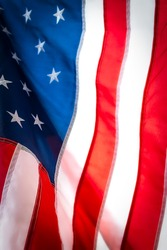 A fifteen star American flag blows in the wind.