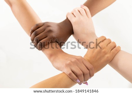 a figure made of an appropriate arrangement of young teenage hands, this time it is a square. Strong wrist grip. Stock photo ©