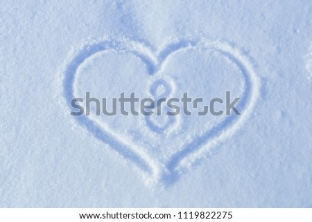 A figure of eight written in the snow in the painted heart. Snow texture. #1119822275