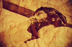 a figure of Jesus Christ carrying the Holy Cross, with a retro effect