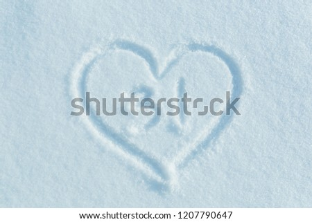 A figure of thirty one written in the snow in the painted heart. Snow texture. #1207790647