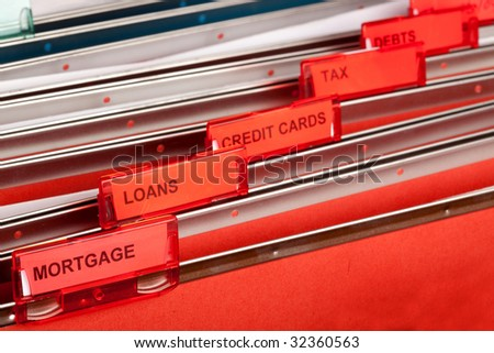 A filing cabinet showing finance related files
