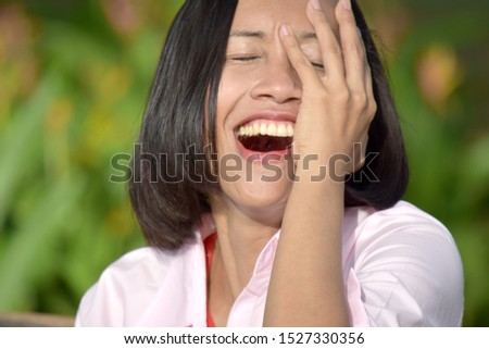 A  Filipina Female And Laughter #1527330356