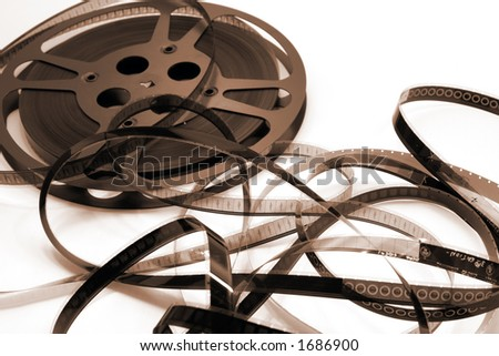 A film reel unwinds and spills into a spaghetti mess.  Focus is on the film strip with 3 and 4 viewable.