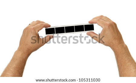 A filmstirp is held by two hands for your images on white