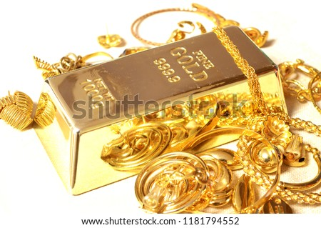 A fine Gold Bar surrounded by compliamenting jewelry.