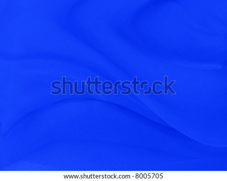 A fine texture of rich blue silk as a background. A natural material