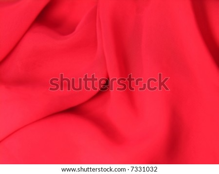 A fine texture of rich red silk as a background. A natural material