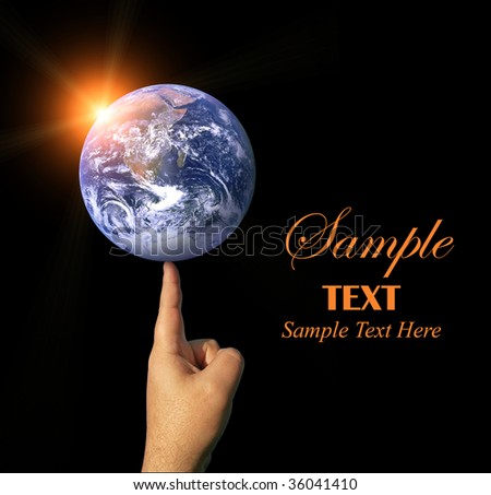 A finger balancing the whole earth with the concepts of environmental awareness and balancing the global economy