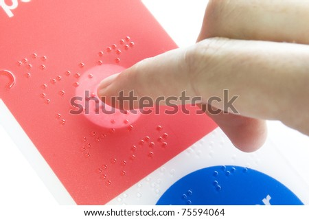 a finger lighting up braille text