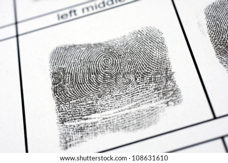 A fingerprint on a white sheet of paper