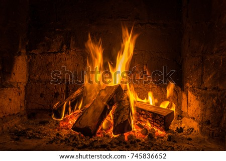 A fire burns in a fireplace, Fire to keep warm. #745836652