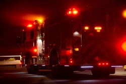A fire engine responds to the scene of an emergency.
