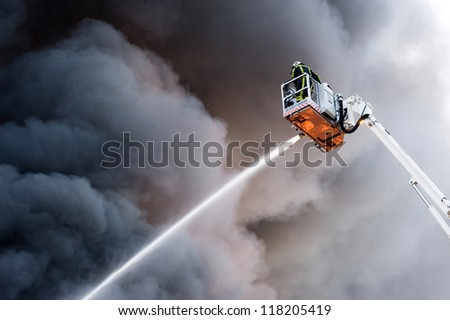 A fire fighter at work in a hydraulic hoist