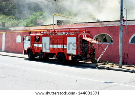 A fire in the street. fire truck