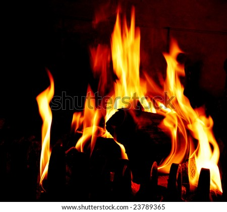 a fire is in a fire-place
