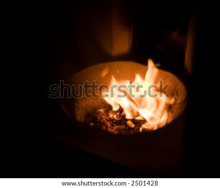 A fire place fueled by burning pellets