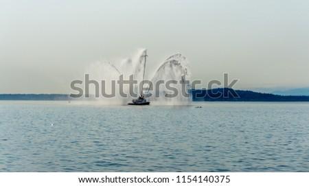 A fireboat shoots water near Seattle. - Shutterstock ID 1154140375