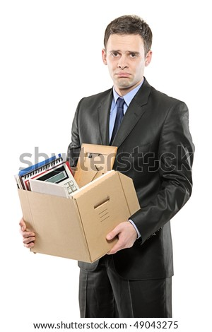 A fired man in a suit carrying a box of personal items isolated on white