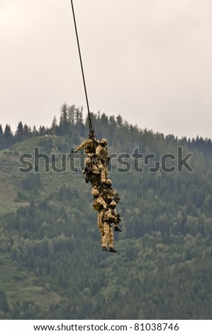 a fireteam of austrian special forces performs a spy rig extraction with a helicopter