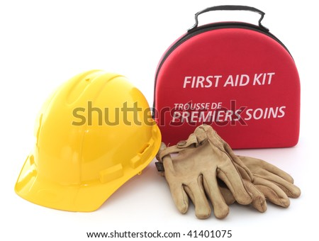 A first-aid kit, hardhat, and gloves spell out the need for safety in the workplace.