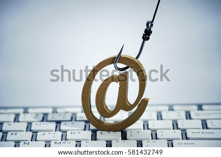 A fish hook with email sign on  computer keyboard / Email phishing attack concept Stok fotoğraf ©