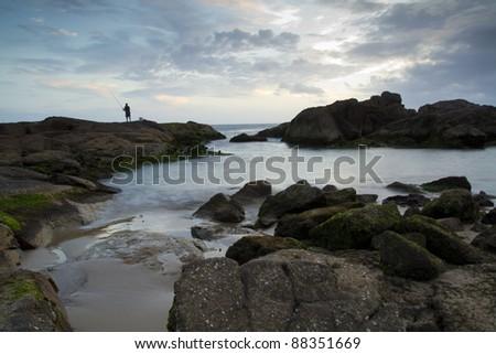 A fisherman at Anna Bay