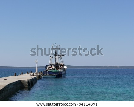 A fisherman boat at the quay of the island Silba in Croatia in the Adriatic sea