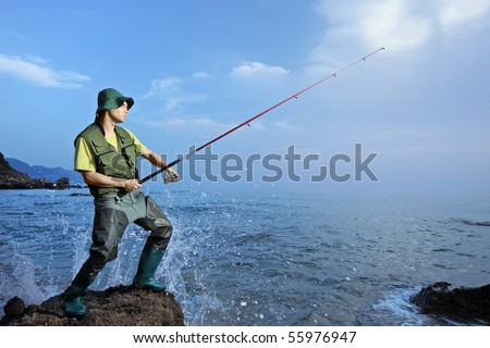 A fisherman fishing at the Ionian sea