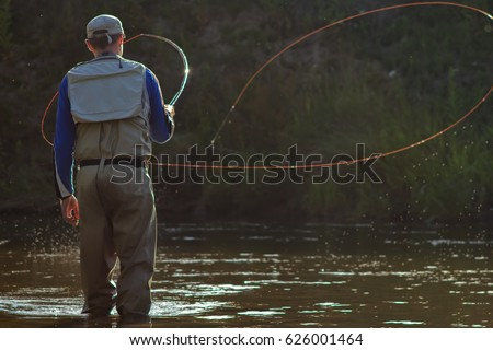 A fisherman fishing with fly fishing. Beautiful cord rings when casting Circle Castes, Voodoo Castes