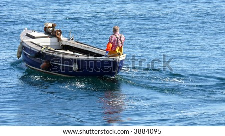 A fisherman going out on his small boat to lift the lobster/crab pots (creels).
