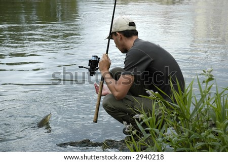 A fisherman just caught a fish