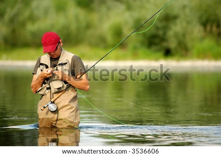 A fisherman make ready angling on the river