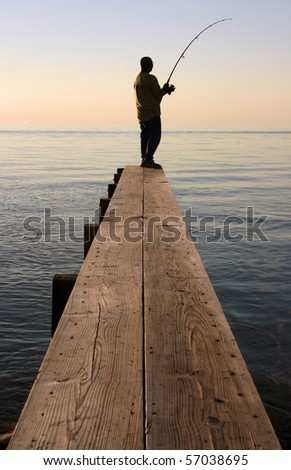 A fisherman on a dock in the Outer Banks, North Carolina