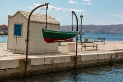 A fishing boat hanged on the peer in the Croatioan coast town of Senj