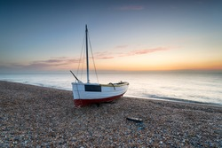 A fishing boat on the beach at Dungeness on the Kent coast
