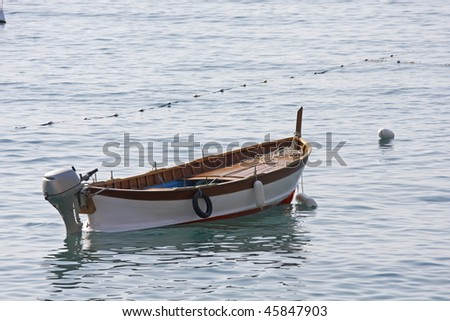 stock photo : A fishing skiff moored in calm water