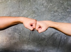 A fist bump or power five is the gesture of giving respect or approval