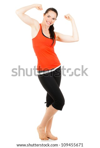 A fit beautiful sporty young woman flexing muscles on both her arms. Isolated on white.